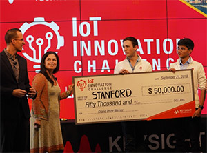 Left: Daniel Bogdanoff (far left), Keysight Master of Ceremonies, and Marie Hattar, Keysight CMO (second left), present Max Holiday and Anand Lalwani (far right) of Stanford with the Grand Prize in the Keysight IoT Innovation Challenge.