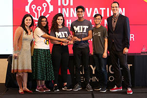 From left Marie Hattar, Keysight CMO, with students from the Massachusetts Institute of Technology who won the Special Prize, The Keysight Diversity in Tech Award for their Smart Land entry, berrySmart, and Daniel Bogdanoff, master of ceremonies for Keysight.